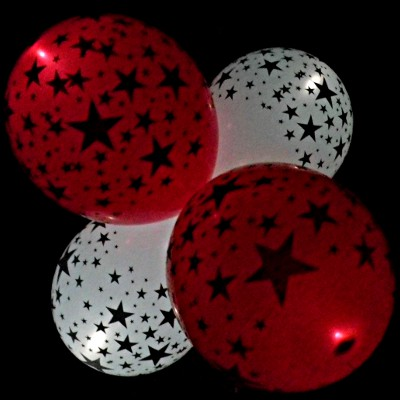 red and white star LED balloons